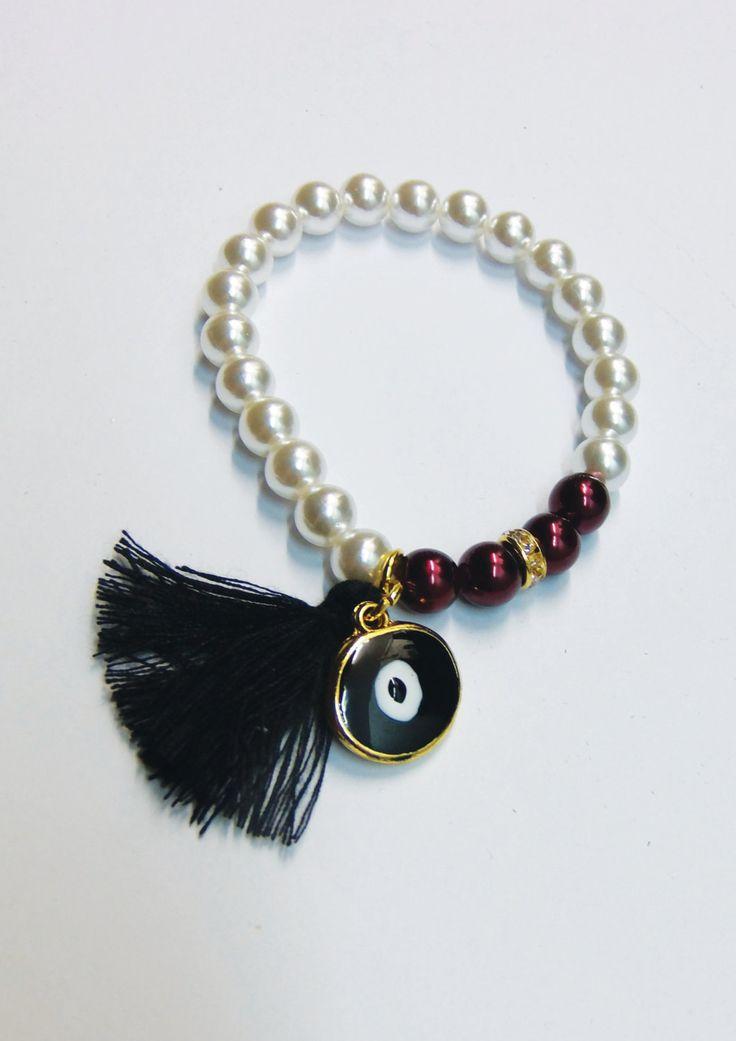 Handmade bracelet/white pearls/red pearls/base metal round charm/gold plated/24 carats/black tassel/white crustals/black enamel/eye by CrownedCharm on Etsy