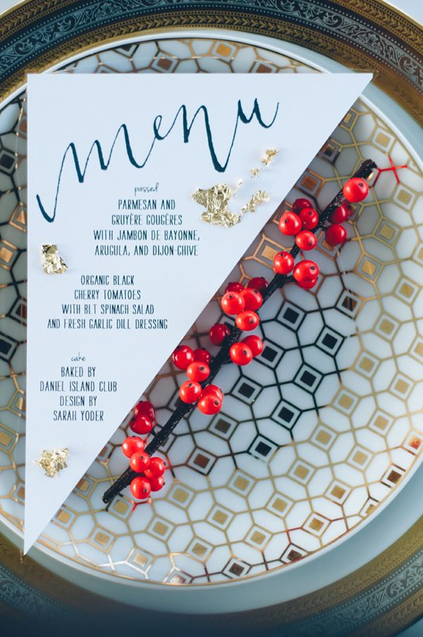 triangle menu card with gold flakes // photo by Sean Money + Elizabeth Fay // styling by A Charleston Bride // paper goods by Mac & Murphy // view more: http://ruffledblog.com/bold-gold-charleston-wedding-ideas