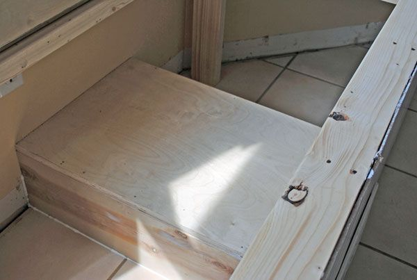 "How to build a window seat from At The Picket Fence ""We constructed a box out of plywood that directed the airflow to the front of the window seat.  The sides and top were glued and nailed, for a tight fit, and then caulked.  This would prevent any loss of heat or air from the vent into the window seat, and would keep a nice flow out the front into the room."""
