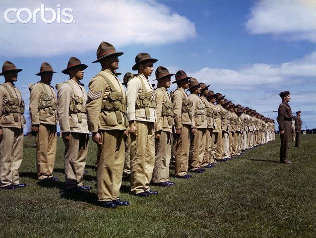 Maoris in uniform stand ready to defend their homeland. 1942.
