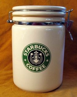 This white Starbucks Coffee canister is ideal for storing coffee beans or ground coffee. It has the old style Mermaid logo.    You can find canisters...