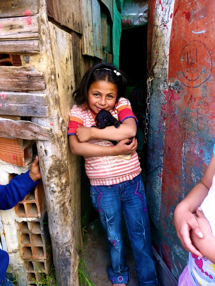 Beautiful little girl in the slums of Bogota, Colombia. Despite her situation which we would see as bad she had the most incredible joy.