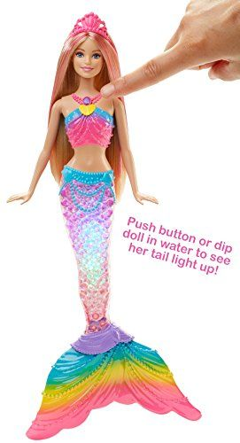 "Make a real splash with this magical light-up Barbie mermaid doll Dip Barbie rainbow lights mermaid doll into water to see her mermaid tail glimmer with colorful lights inspired by a sparkling rainbow Press the button in Barbie doll's necklace to switch her to ""on"" mode, and dip her into the tub or pool to activate the light show...  toys4mykids.com"