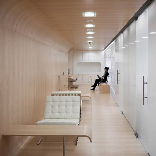 Designed by the Madrid-based Estudio Arquitectura Hago, this dental office is located on the second floor of an office building in Málaga, Spain. Carefully considering the spatial layout and the flow of patients, they constructed a huge, translucent white glass wall that divides the waiting area from the corridor.