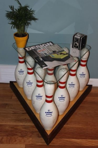 bowling pins turned table...would be cool for the bowlers out there. I'd probably just use three with one at each corner, so you could have more storage.