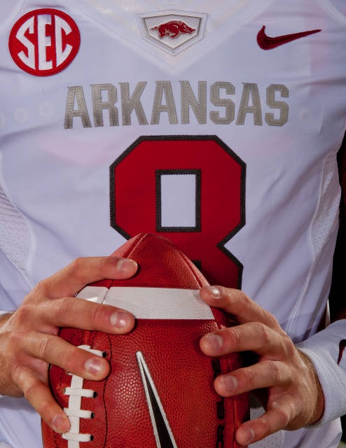#Razorbacks starting Quarterback Tyler Wilson modeling new jersey for the 2012 season.  You'll also want to check out ~ RollTideWarEagle.com  ~ great sports stories, audio podcast and FREE on line tutorial of college football rules. #CollegeFootball
