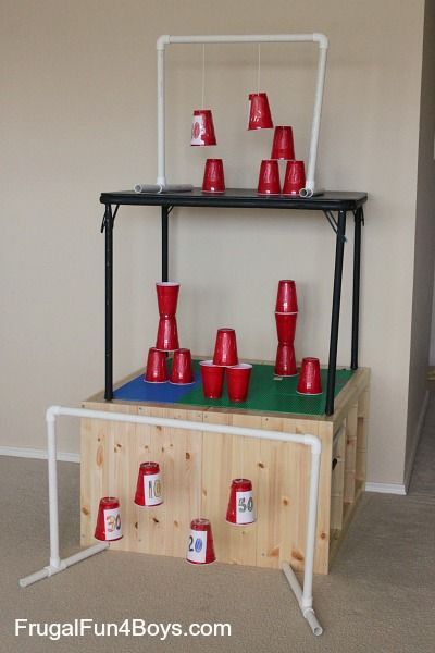Plastic cups make awesome Nerf targets, and when the cups are swinging, they're even more fun!