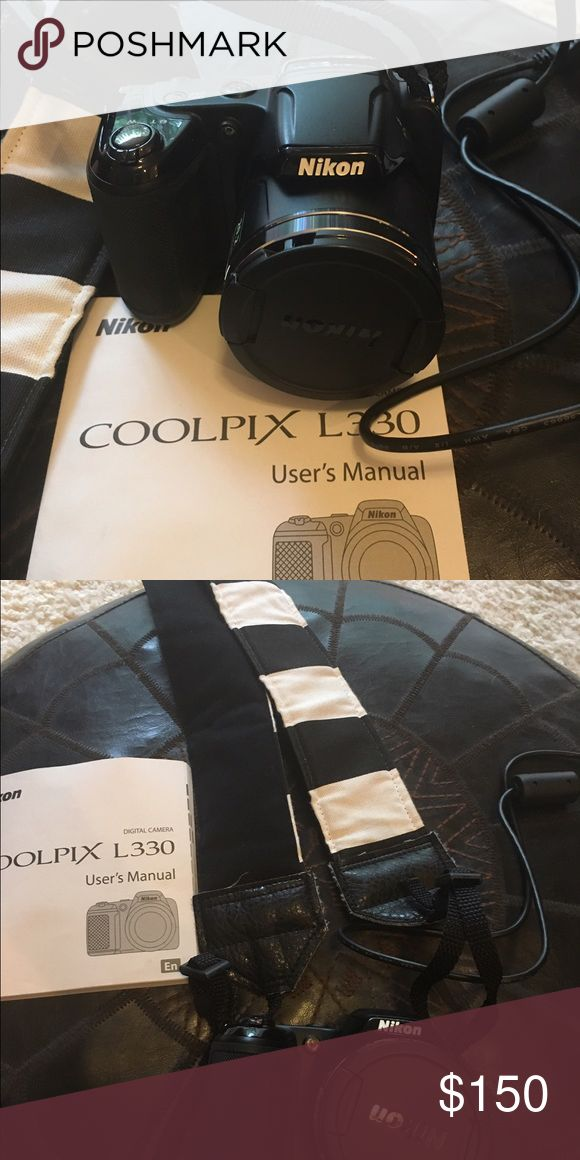 Nikon Coolpix L330 Mint condition. Only used once for a week long trip. Includes handmade strap from Etsy. Nikon Other