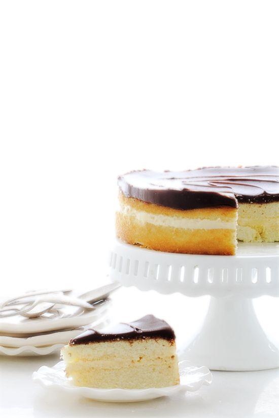 Boston Cream Pie with vanilla pastry cream and chocolate ganache glaze.