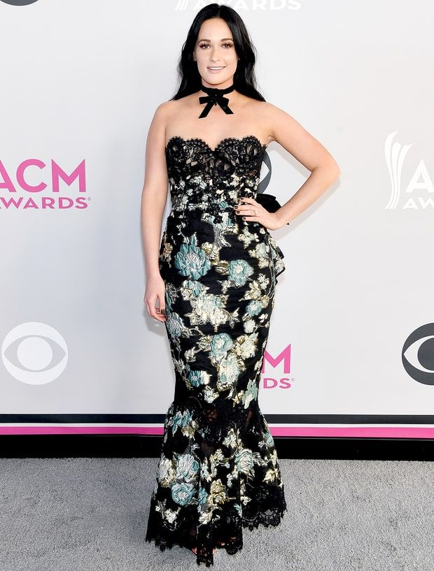 Kacey Musgraves in a floral lace Marched mermaid dress with a bow-accented choker necklace.
