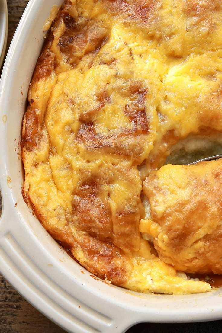 Nigella Lawson's recipe for savory baked croissant pudding, which goes by the name of French lasagne in her house, uses up stale croissants by having the cook split and stuff them with ham and cheese, sprinkle more cheese over the top and douse them in eggs beaten with garlic-infused milk.  (Photo: Jim Wilson/The New York Times)