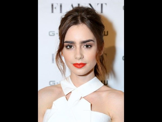 Rachel Murray/WireImage Coral is looking to be the lip color of the season. Like Lily go with a lighter eye—loads of mascara and a natural-looking eyeliner to put focus on the bold lip.        So yes, budding It Girl Lily Collins is one of those blessed at birth women who can pretty much wear any lip color and look amazing. (Phil's genes, perhaps?) But there is a lesson is to be gleaned from the Mortal Instruments star's whirlwind week of movie promotion—try as many colors as you possibly…