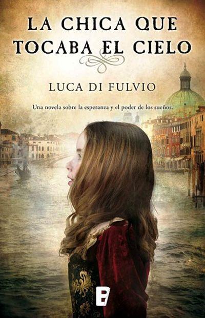 """La Chica que tocaba el cielo / Luca di Fulvio: """"Venecia, 1515. Mercurio, un joven amante de la libertad, huye de Roma a causa de un terrible incidente. Aunque parece un ladrón, en el fondo es una persona honesta y buena. Esa es quizá la razón por la que Giuditta quien ha llegado a Venecia junto con su padre, un judío que ha dejado su tierra natal se enamora de él ..."""""""