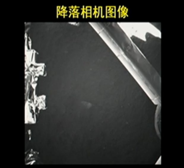 This photo from China's Chang'e 3 lunar lander shows the landing site terrain on the moon after a successful Dec. 14, 2013 landing. This image was beamed live to Earth and broadcast by the state-run CNTV news channel.
