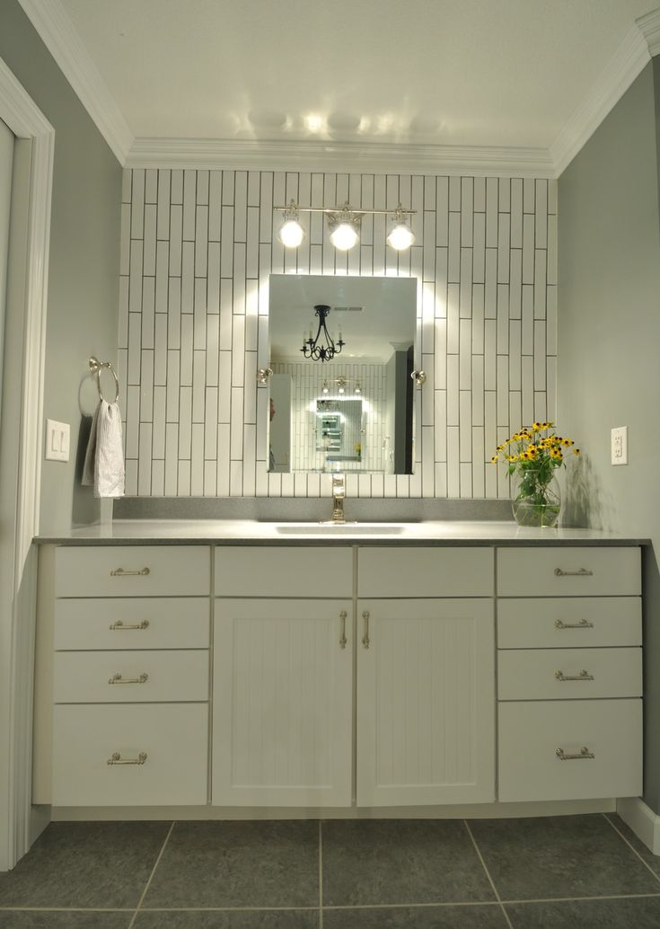 Like the vertical Subway tile. Maybe we could do a wall like this in the master behind the 2 sinks :)
