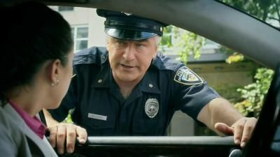 Officer Alec Baldwin is on the job, telling everyone how much faster they'd be traveling if they used the Capital One Venture card. - iSpot.tv