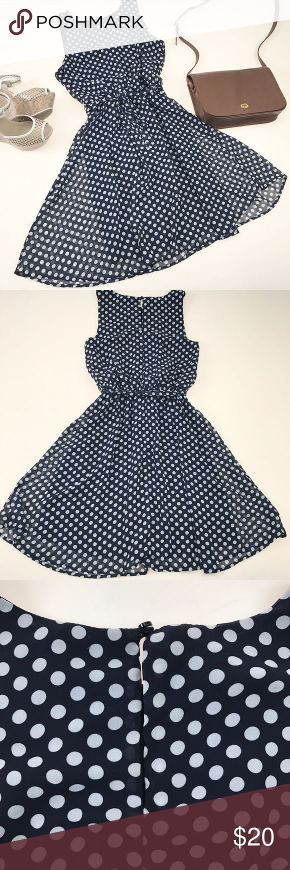 Navy and White Polka Dot Swing Dress with Tie This stunning dress features a tie around the waist and an elegant flow skirt.    The material is light and nearly transparent over a built in slip. Lightly worn, there is some minor wear to the underarm, but this dress comes in good used condition.  The measurements shown are (in order) length, bust, and waist (flat lying, double for around.) The waist is elastic and leaves much much room for stretch.   🍑 Send any offer (even lowballs!) and I…