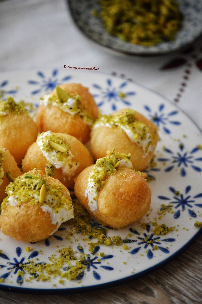 http://savoryandsweetfood.com/2016/06/09/luqaimat-cream-sweet-fried-dumplings/