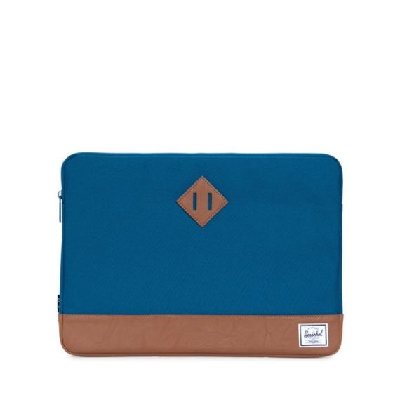 Herschel Laptop Sleeve Never used!! Pretty turquoise laptop sleeve from Herschel's Heritage brand! Fits a 15 inch MacBook. The only reason I'm getting rid of it is because it didn't fit my Dell laptop. Herschel Supply Company Bags Laptop Bags
