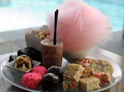 Lick Your Lollipop: The Top 5 Candy Shops in Las Vegas - Haute Living-the Junk Food Platter, an assortment of cotton candy, brownies, Hostess-inspired cupcakes, Snoballs, Rice Krispies and Froot Loop treats