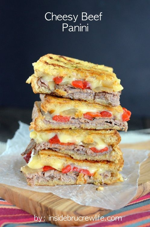 Cheesy Beef Panini - roast beef, melty cheese, onions, peppers, and garlic toasted in a toasted panini sandwich.