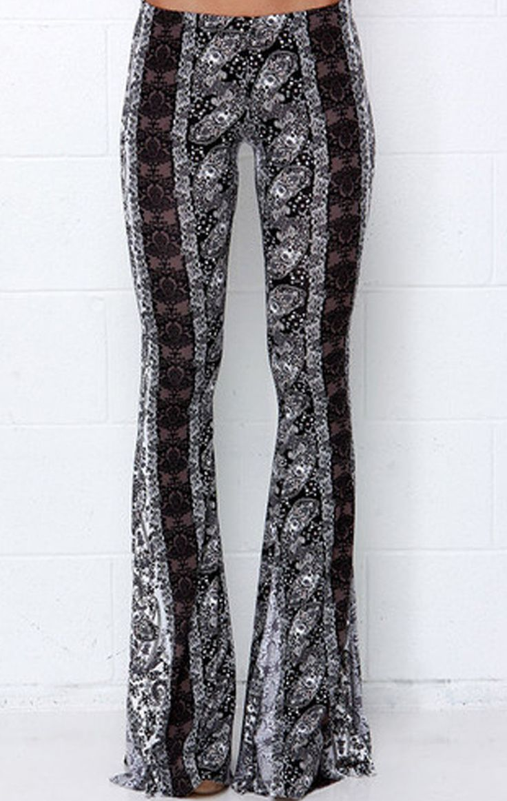 Her printed pull-on bell bottom trousers showcase a stretchy elastic waist band for a comfortable, yet bold look.