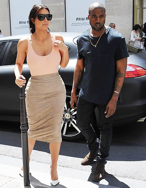 Kim Kardashian went braless in a clingy top on May 19, days before her wedding to Kanye West on May 24