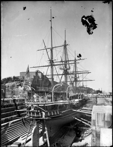Glass plate negative , HMS Curacoa of Imperial Squadron in dry dock on Cockatoo Island
