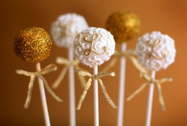Glittery monogramed cake pops.  Fun for a wedding.