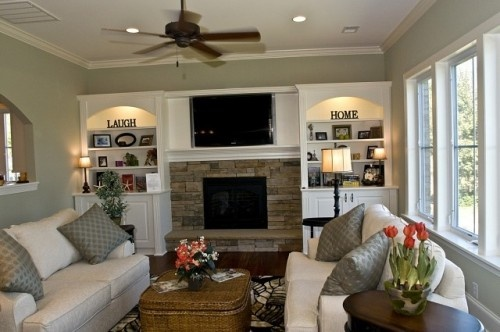TV in recessed area above fireplace, nice built-in lighted shelves above doors. Very comfortable seating make for a very comfortable looking room.: Living Rooms, Idea, Built Ins, Livingroom, Fireplaces, Builtin, Family Rooms, Room Design