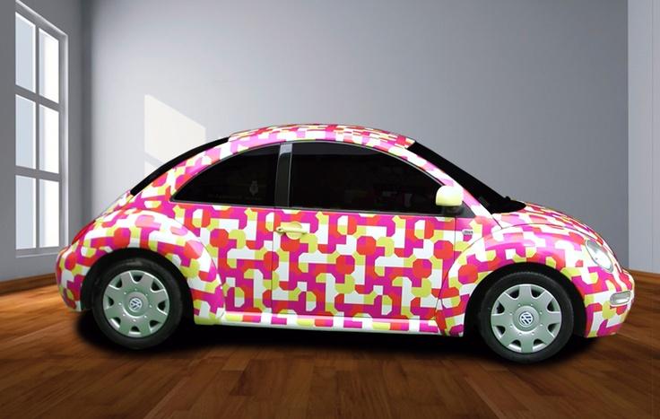 Wrapping volkswagen new beetle tramite adesivi stampati in quadricromia per studio grafico Guido Borgonovo.  www.guidoborgonovo.it