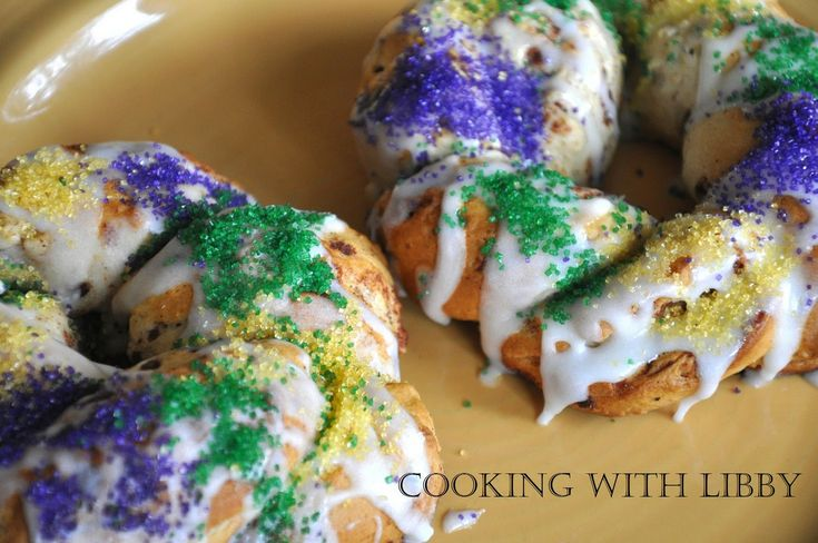 GOOD ILLUSTRATION HOW TO ROLL - made with 1 can/tube of refrigerated cinnamon rolls (with frosting included)  Purple, yellow, and green sugar crystals