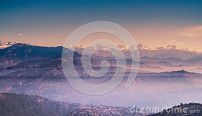 Multi layers of hills and a range of mountain of Nepal