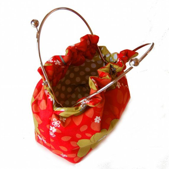 Frame purse with Spring blooms on red. $70.00, via Etsy.