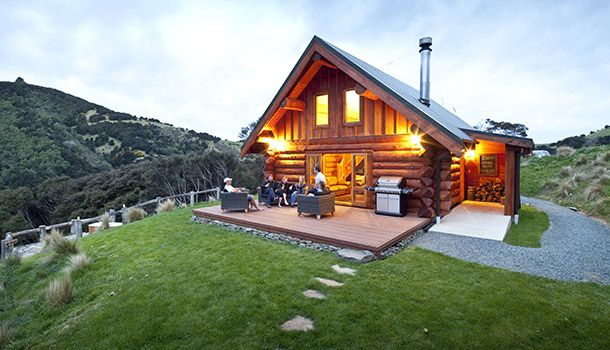 Nothing says autumn bliss like a log cabin. From rustic lodges to luxury chalets, these log cabin rentals have stunning fall views and a campfire-snug vibe.