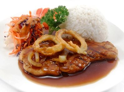 SALMON TERIYAKI, served with rice, coleslaw & onion rings, in delicate teriyaki sauce.