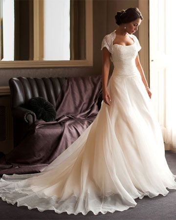 Anastasia - A classic gown of beaded lace and Italian soft sheen silk organza, finished at the waist with finely pleated satin. The butterfly bolero beautiful complements this gown but she also looks fabulous with Lady Mary's straps.