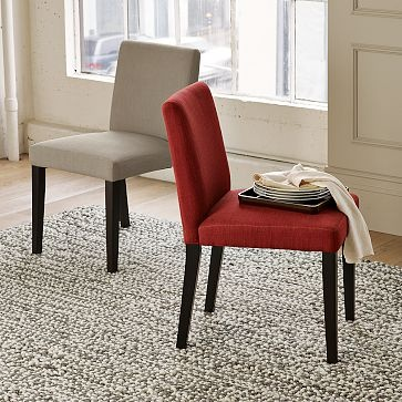"""Porter Upholstered Dining Chairs. Solid wood frame with cotton basketweave upholstery; solid wood legs. Fabric: Chili, Sandstone, Flax, Vapor. Legs: Chocolate-stain19""""w x 23.5""""w x 34""""hWest Elm$149"""