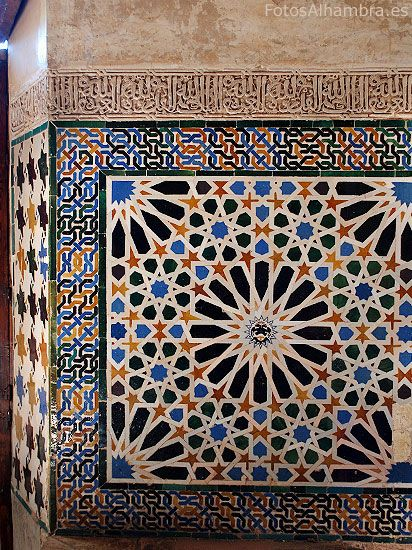 Tile work and calligraphy in the Mexuar Hall, Alhambra, Granada, Spain; 14th century. This room has undergone major changes since its foundation, but the exquisite painted ceramic tile work and continuous band of calligraphy remains. We see many typical Islamic motifs, including geometric designs, such as the eight-pointed star, the use of bold colors, a focus on symmetry, and a sense of infinite repetition.