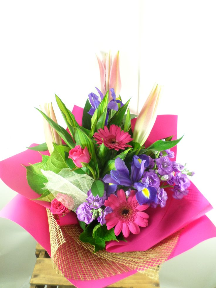Beautiful bright bouquet made with Lily's gerberas some fragrant stock and iris. Created by the team at Florist ilene