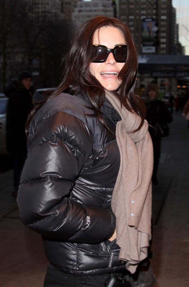 "21da76393 ... Courtney Cox in black The North Face ""Nuptse"" down jacket ..."