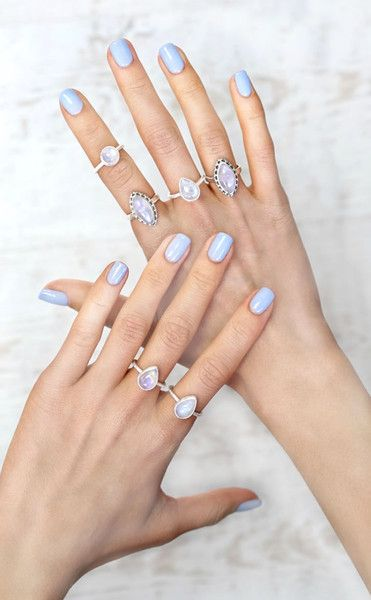 Beautiful moonstone gemstone rings from LVNDR with blue nails by Nails Inc