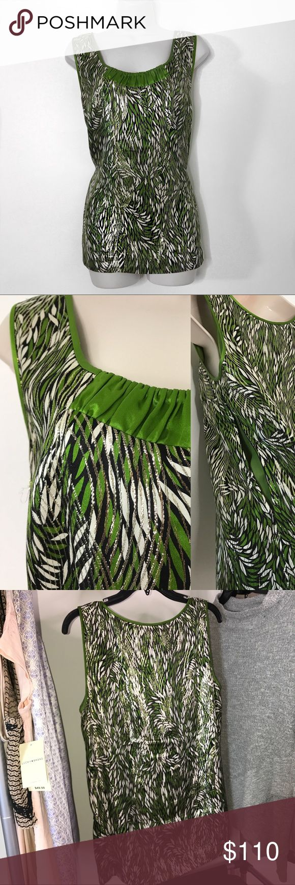 Tory Burch Green Metallic Blouse Tory Burch Blouse with green ruffle detail and a beautiful metallic multi print sheen  Zipper on side to put on and off  Size 12 Originally $319  If interested or have questions feel free to inquire ♡ Tory Burch Tops Blouses