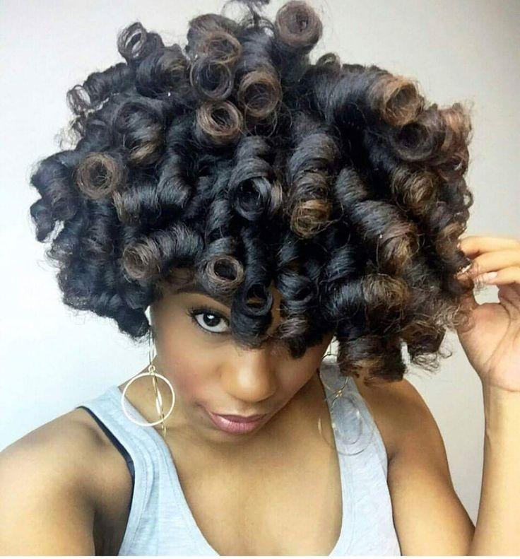 Large roller set curls on natural hair.