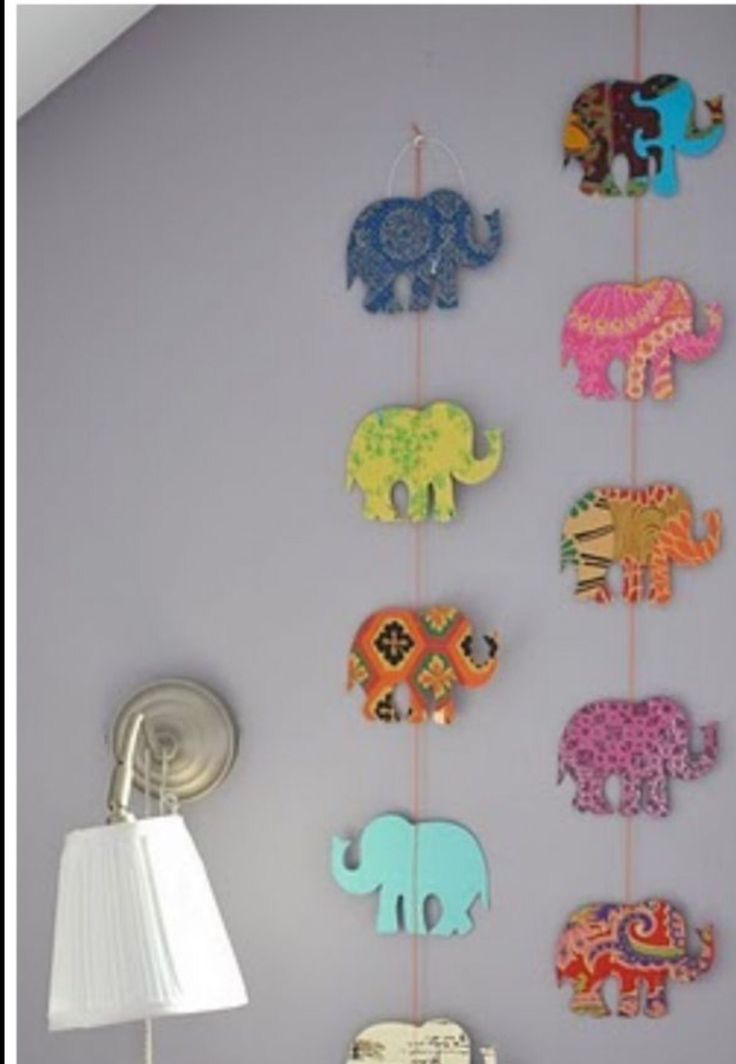 Cut any shape out scraped booking paper a hot glue it to some string something fun easy to give you room some flair