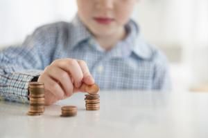 Token economy systems motivate kid to change their behavior fast. - Jamie Grill / Getty Images