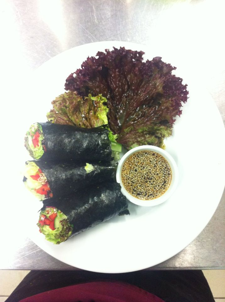 Nori rolls packed with herbs, sprouts and microgreens with spicy sesame dipping sauce. Raw.