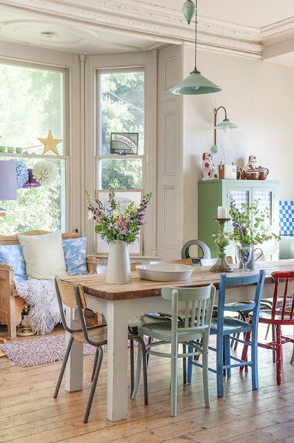 Pretty dining table, rustic, colourful, fresh + mis-matched chairs + lovely bay window!