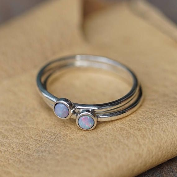 Custom made to order stackable rings. Available materials: •Gold •Sterling Silver •Bronze  I am able to source most gems or stones.  Rings shown in images are made in Sterling Sivler with opal, Chalcedony, and Fire Opal stones.   *Price is dependent on material choice