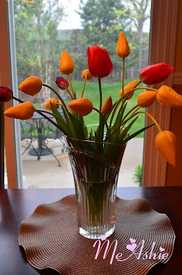 Freshly cut Tulip flowers from my front yard. I was going to just leave it alone, but when i heard the weather forecast tonight that we will have a storm, and so I decided to cut them and placed it at my dining room.Dining Room
